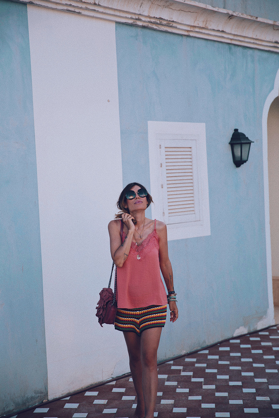 Bárbara Crespo streetstyle. Multicolored crochet shorts and lingery top. Summer style. Coachella